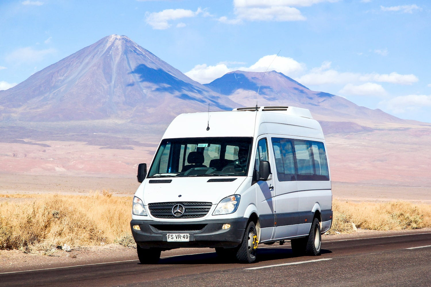 mercedes sprinter van in front of a mountain