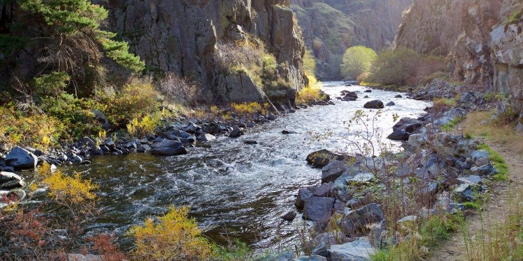 rail adjacent to river in hells canyon national recreation area.