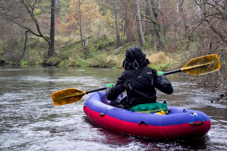 man pack rafting down river