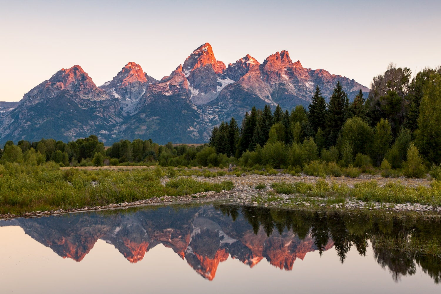 lake and Grand Teton National park at sunrise