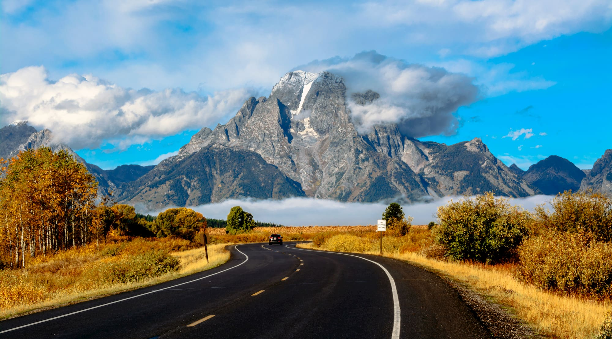road leading towards grand teton