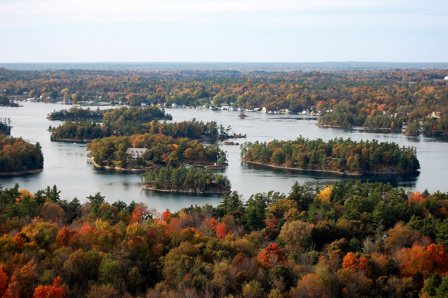 wide shot of thousand islands ny in fall