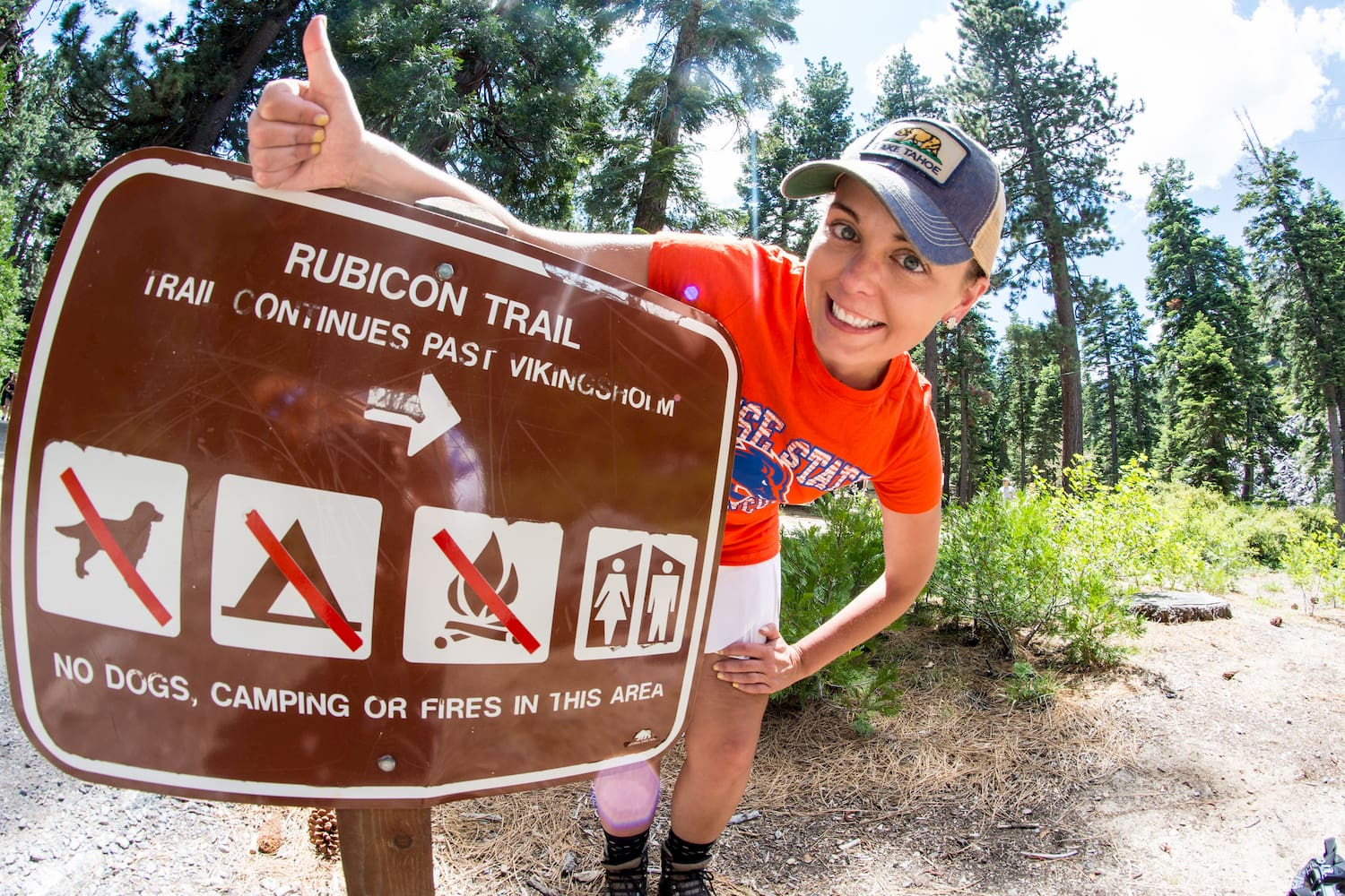 woman with rubicon trail sign