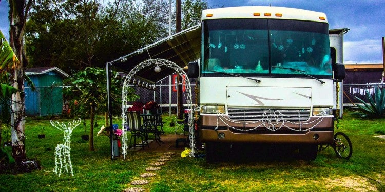 rv in rv park with winter lights