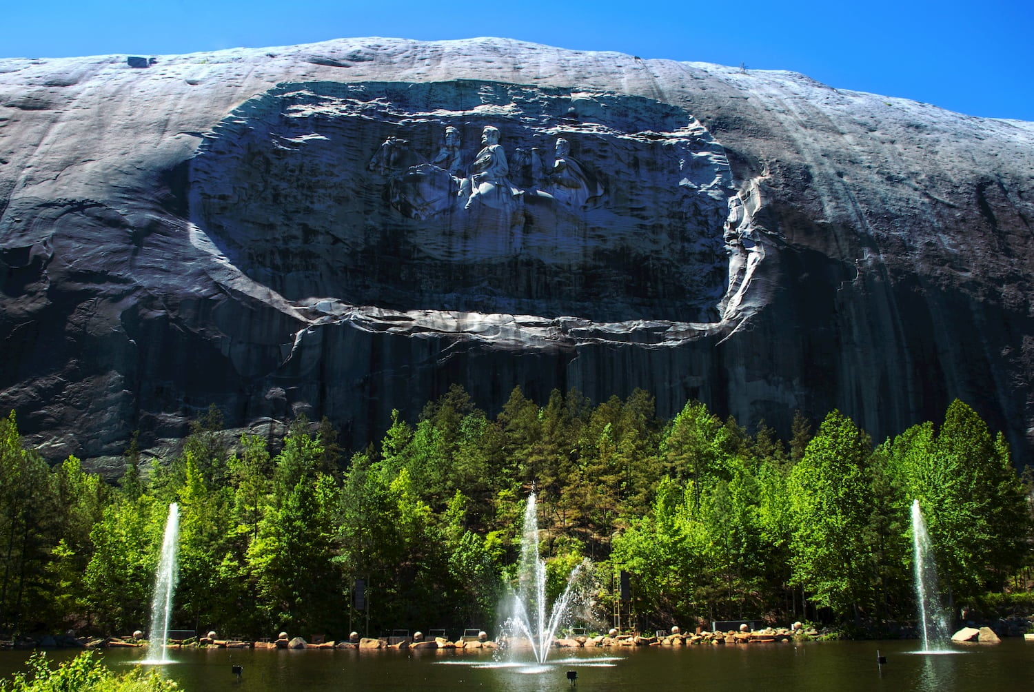 stone mountain with fountains in foreground