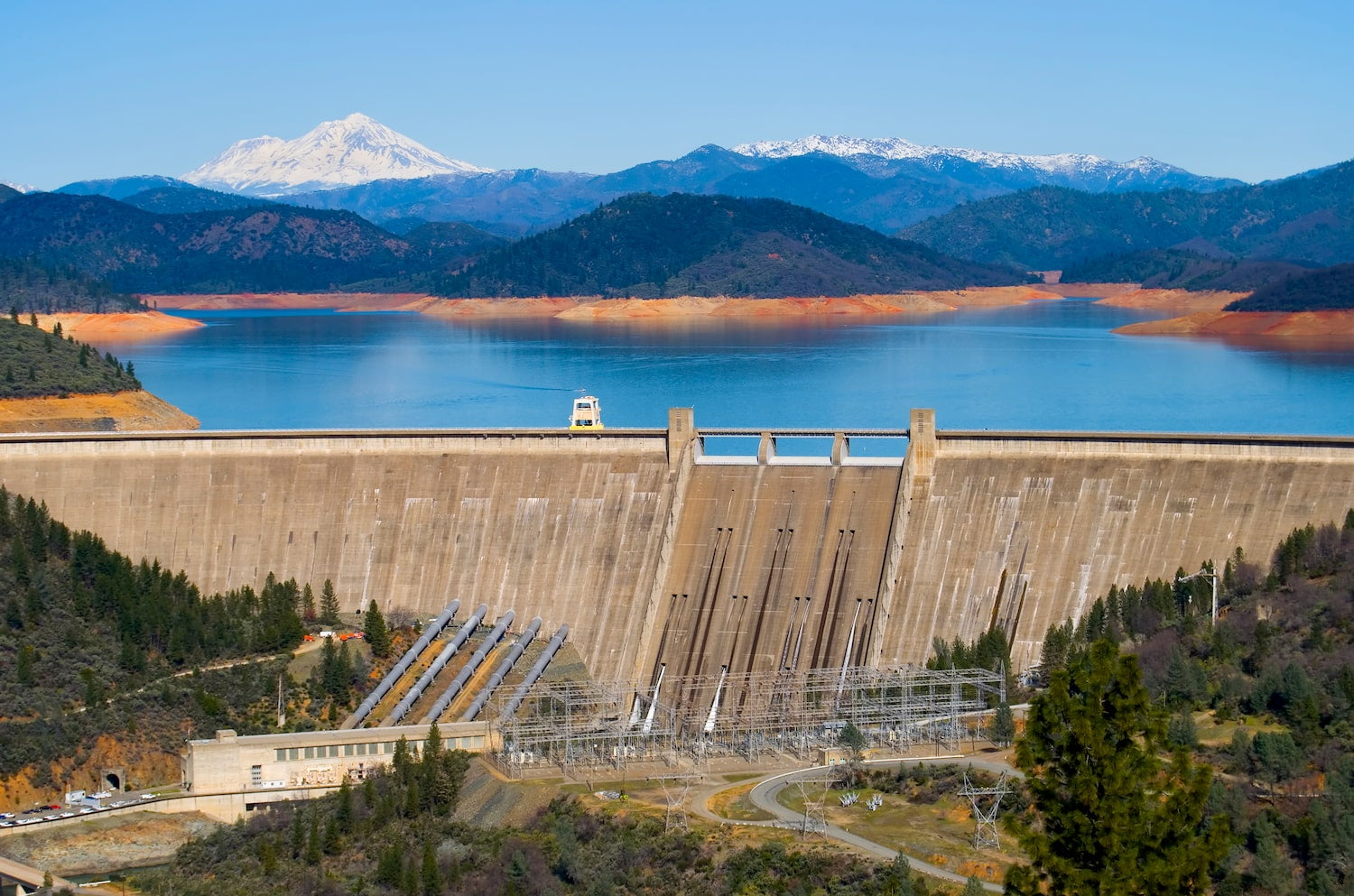 shasta dam with mount shasta in background