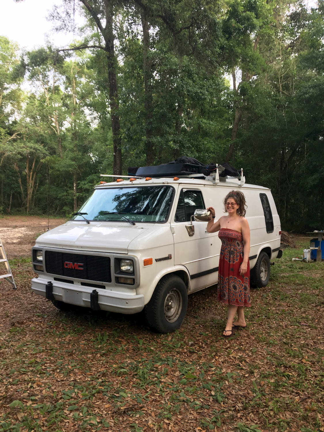 Suzy standing next to her van
