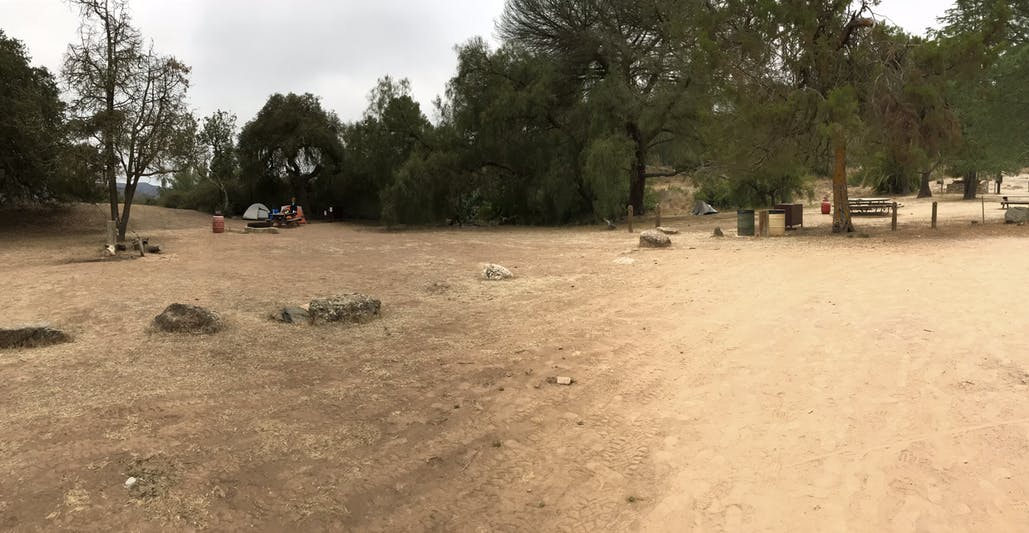dirt patch of campground with tent in background
