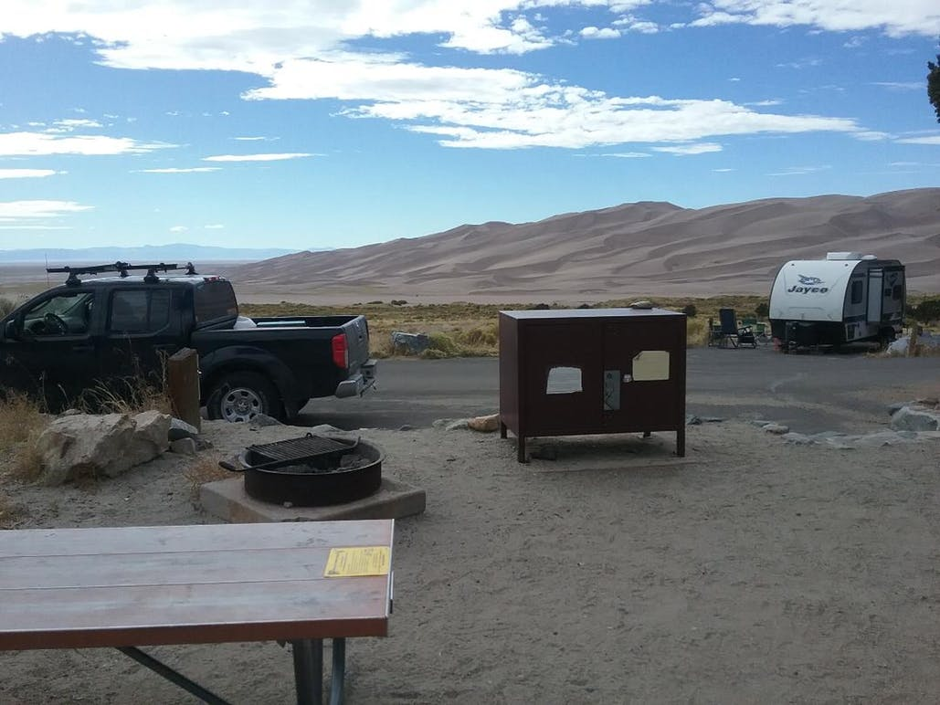 Campsite and sand dunes at pinon flats campground