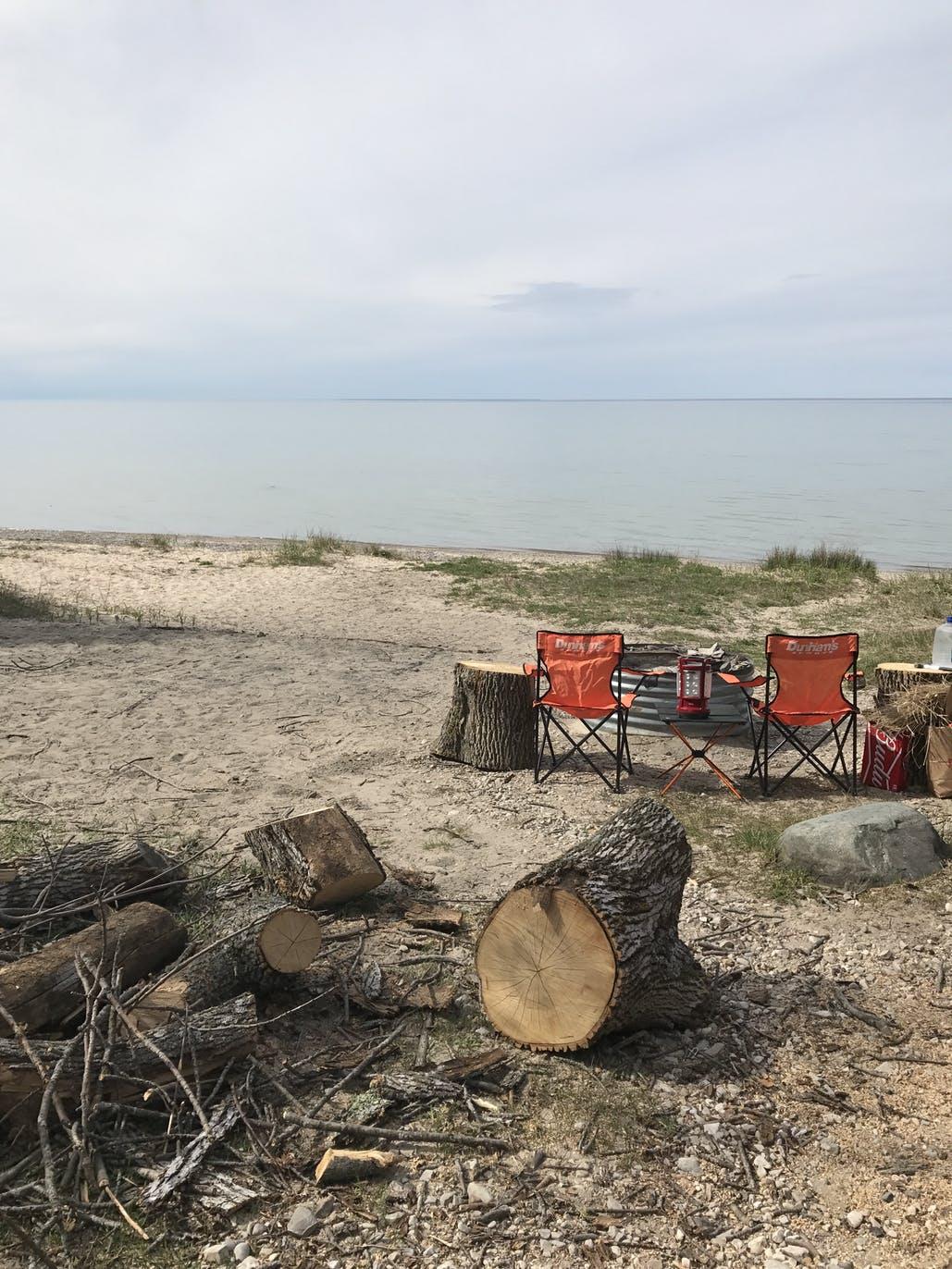 chairs on beach overlooking lake
