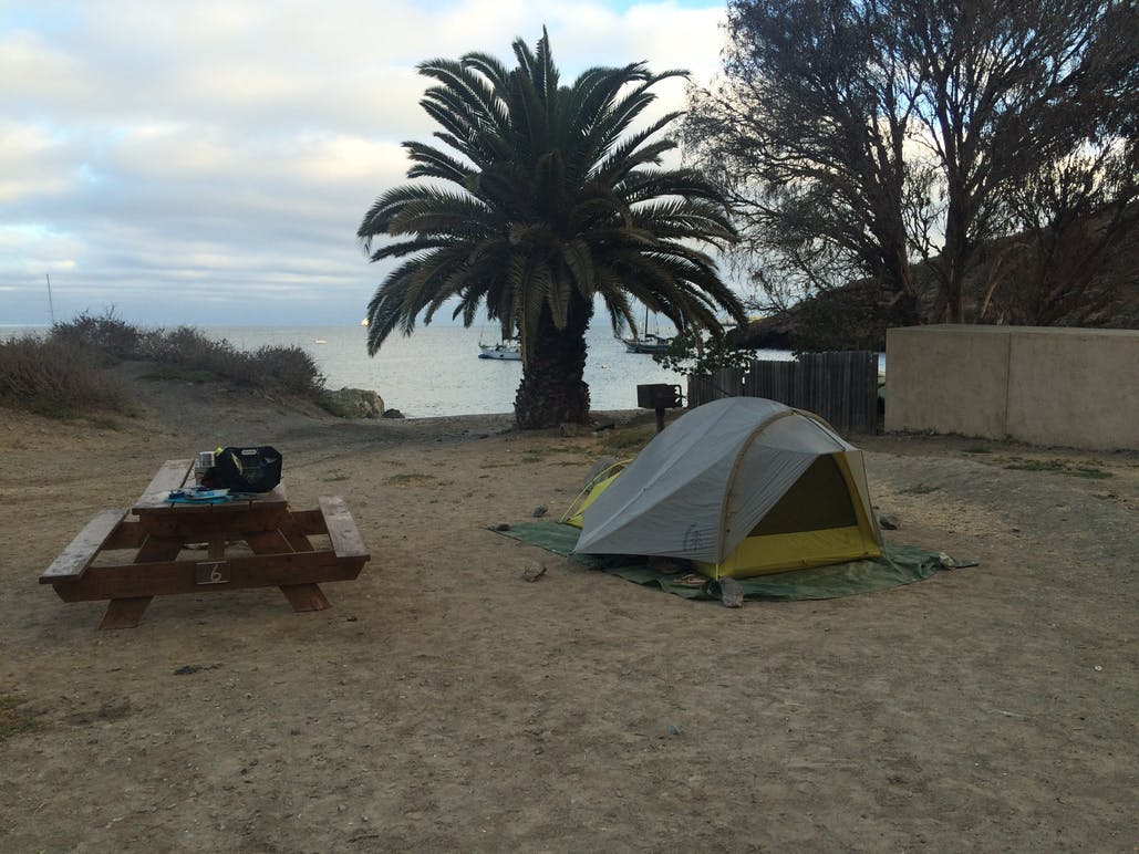 tent and picnic table on sand