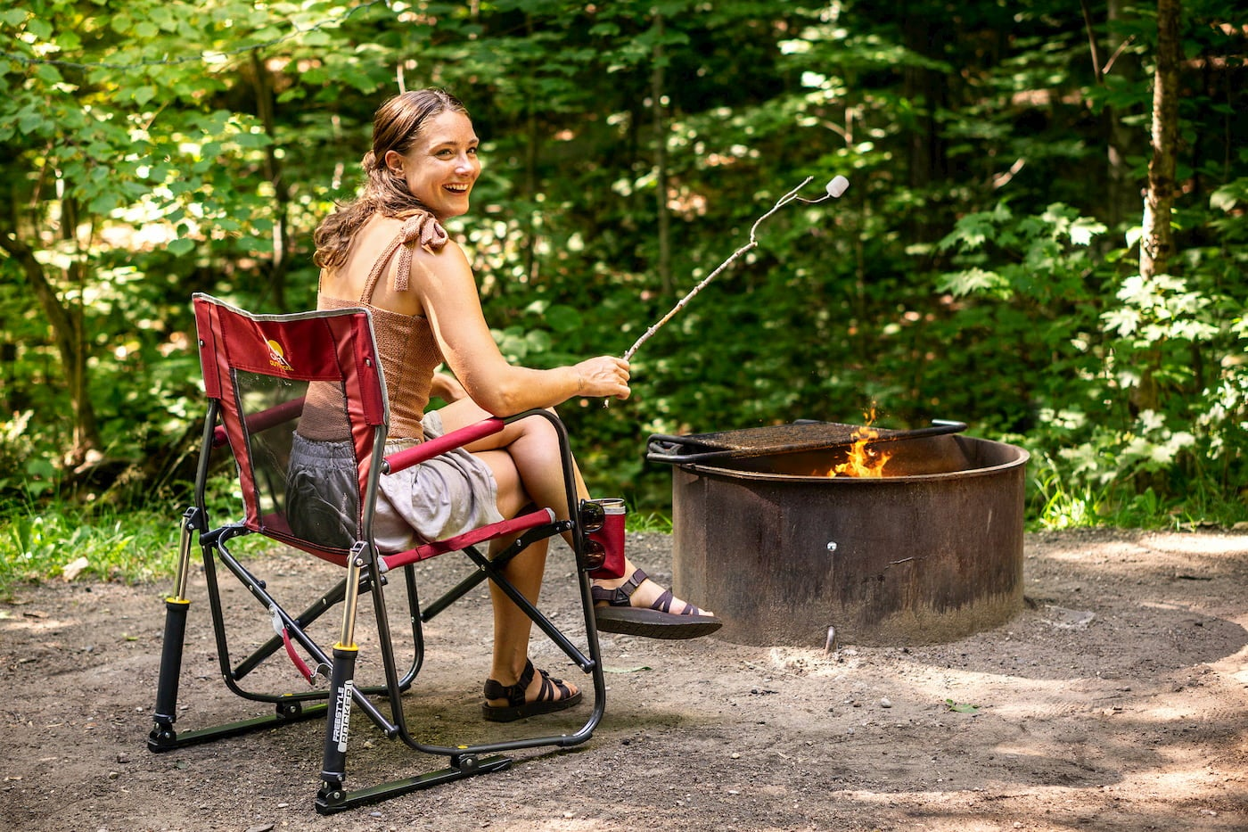GCI outdoor chair used for grilling over a campfire.