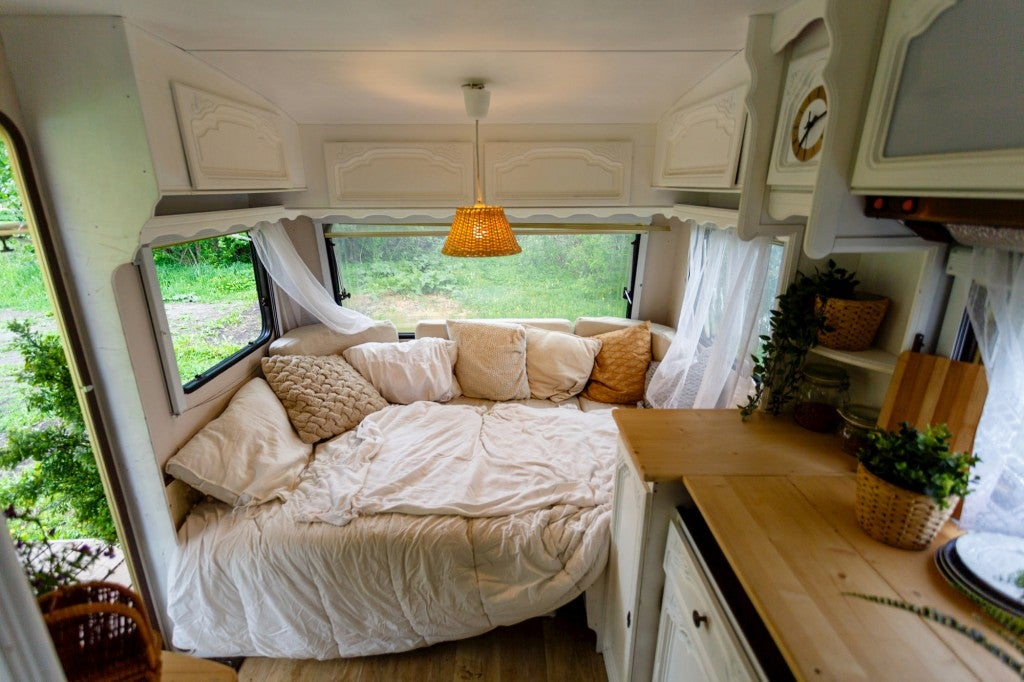 inside of rv, bed and day bed