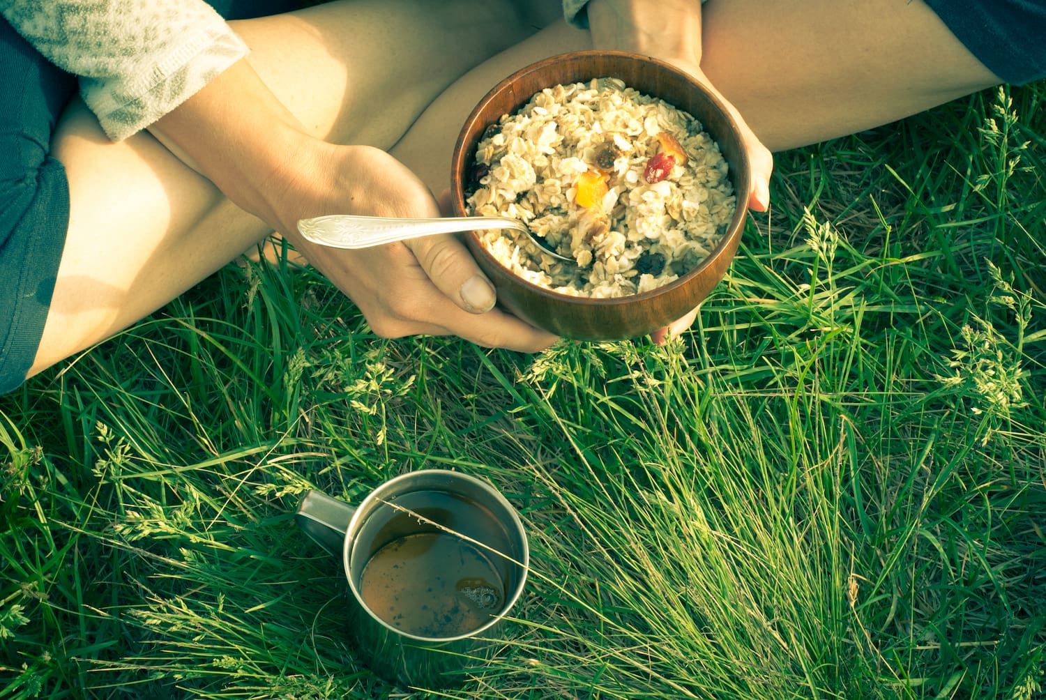 someone holding pot of oatmeal in grass