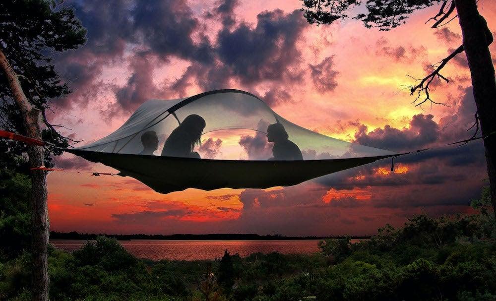 Suspended Tentsile hammock tent setup at sunset.