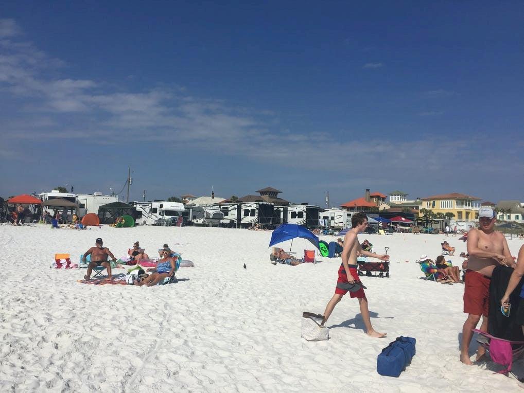Beachgoers at an RV park beach.