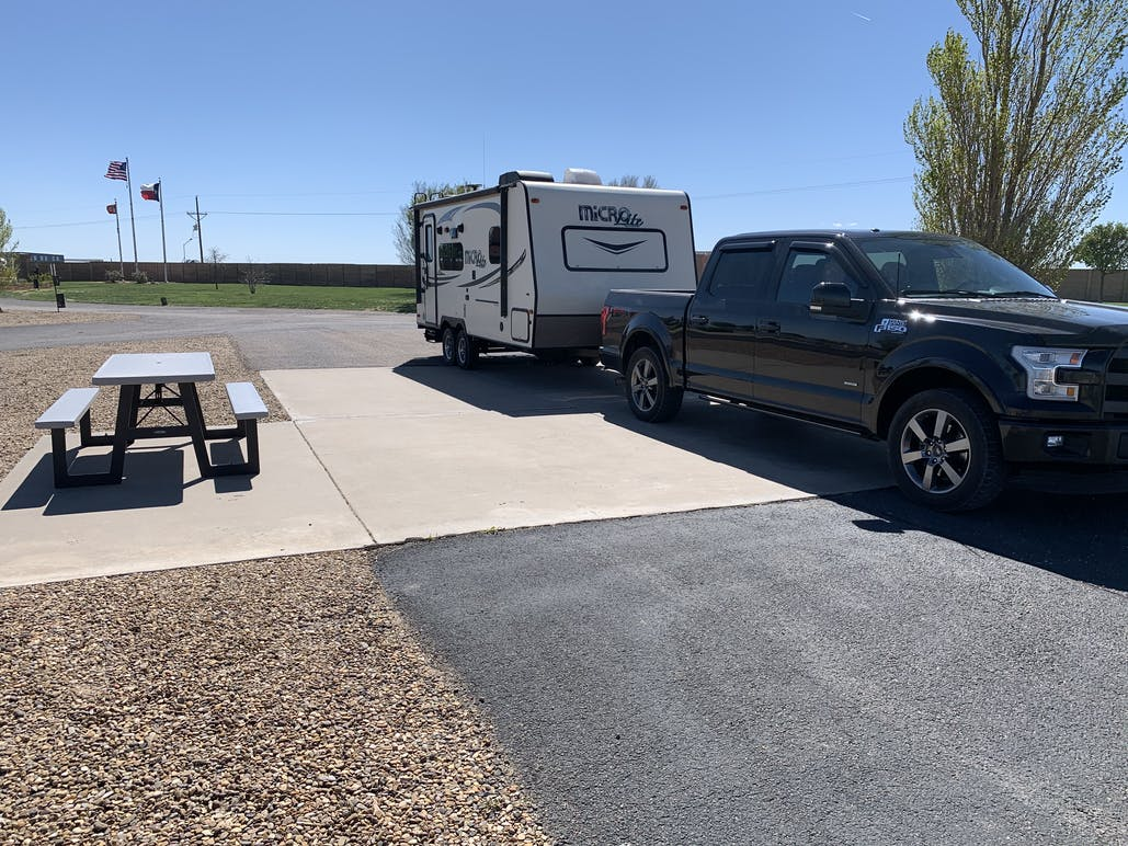 truck with trailer camped at campsite with a picnic bench