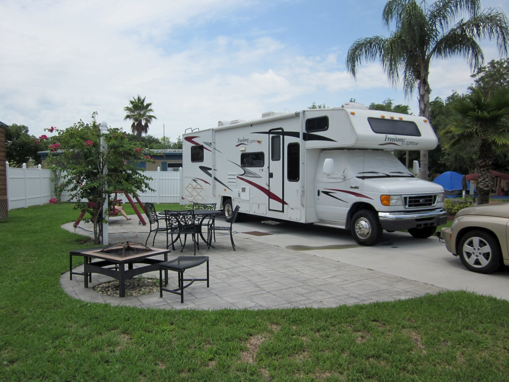RV parked beside picnic table at campground in florida.