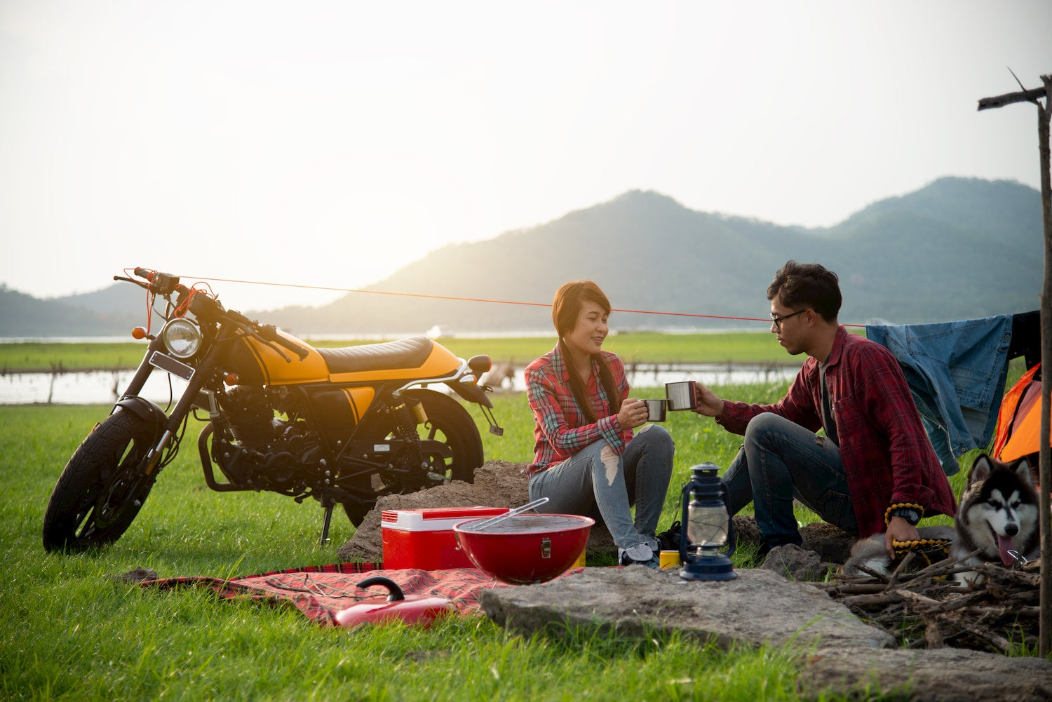 couple eating food while motocamping