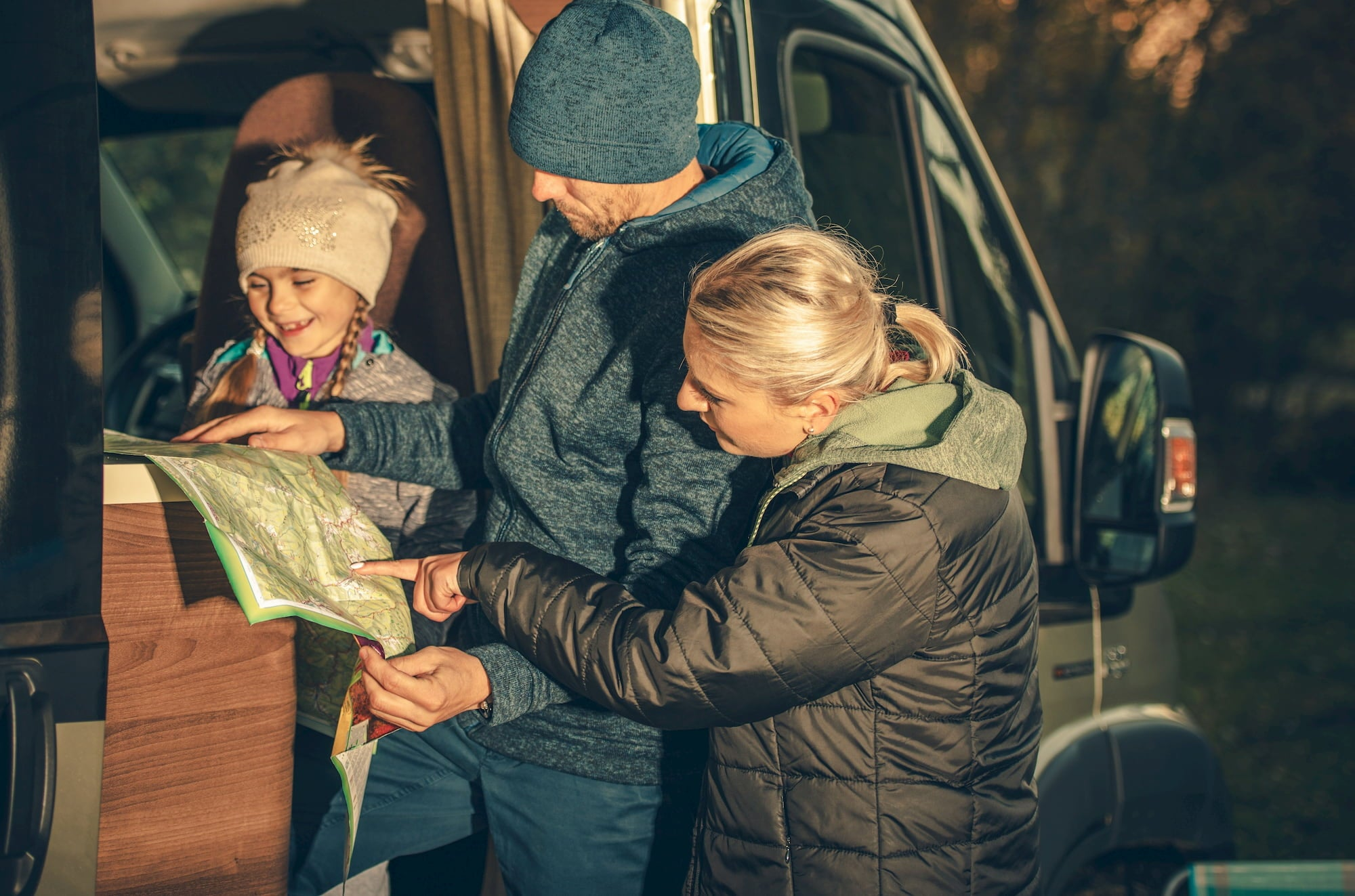 Family planning trip via a map in RV/sprinter van.