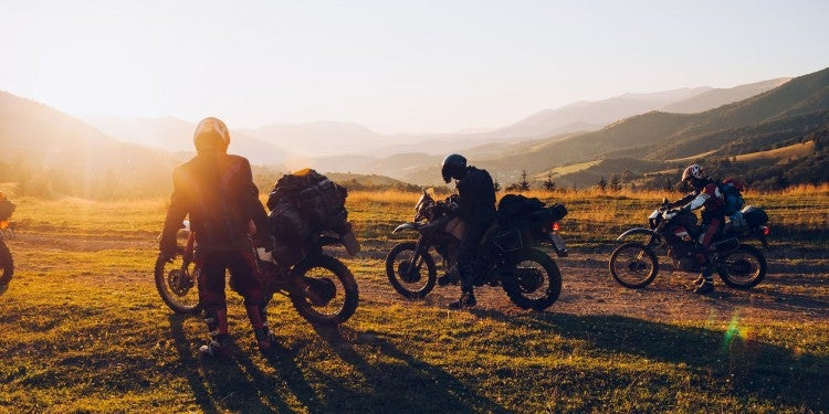 motorcycle campers at sunset
