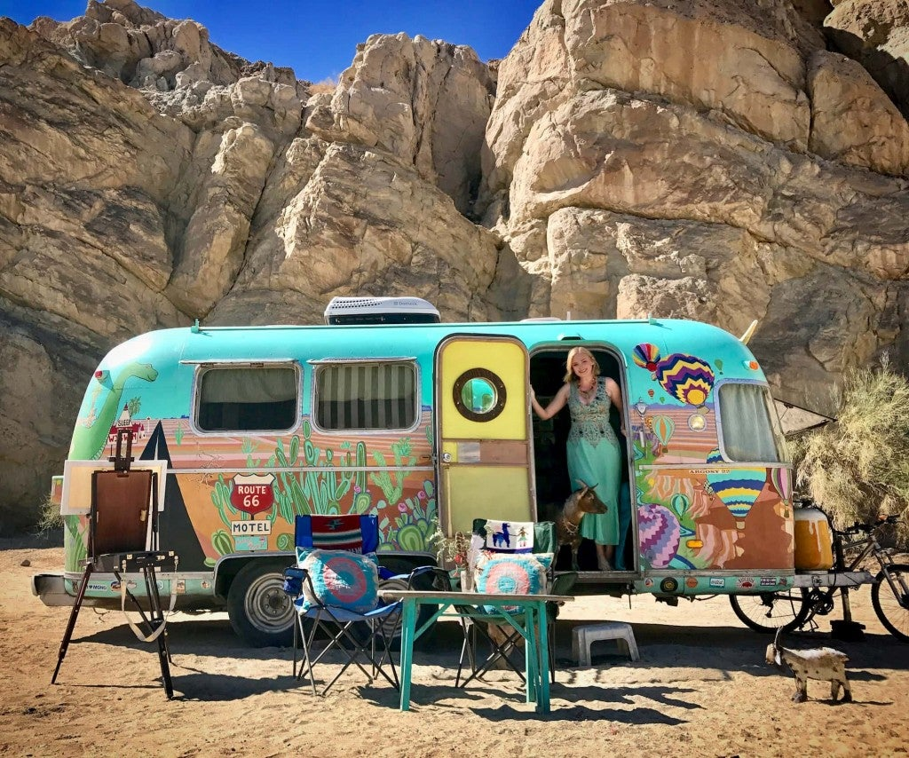 Cate of Argosey Odyssey posing with her hand painted airstream.