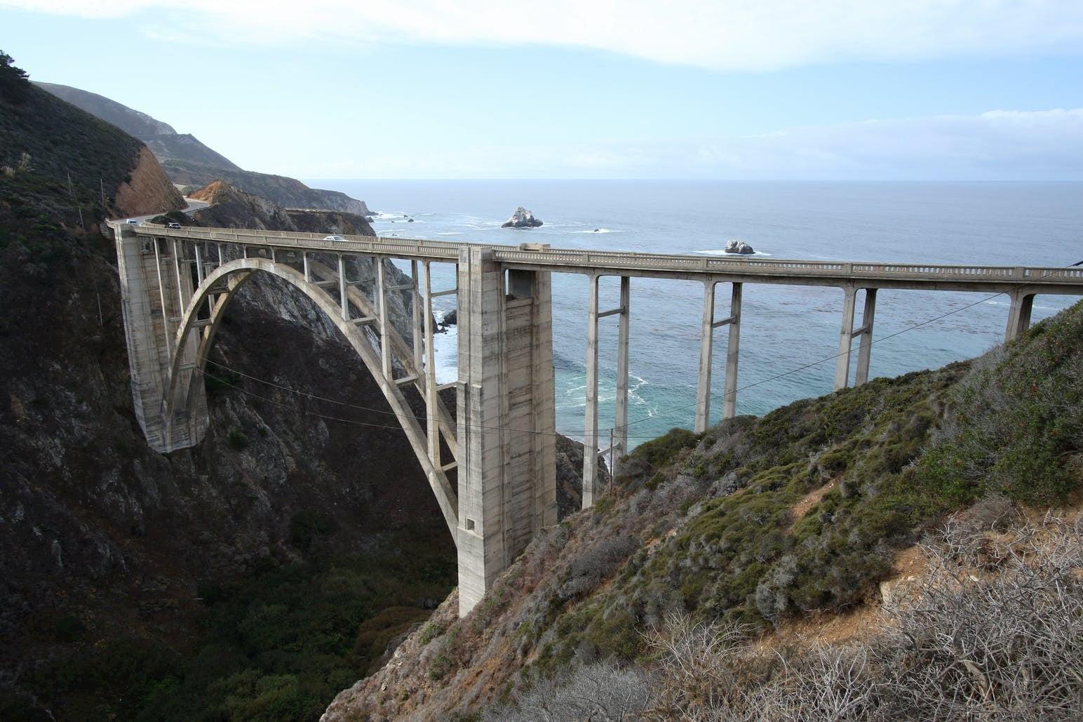 Large suspended bridge between coastal cliffs in Big Sur.