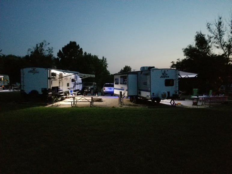two RVs side by side at night