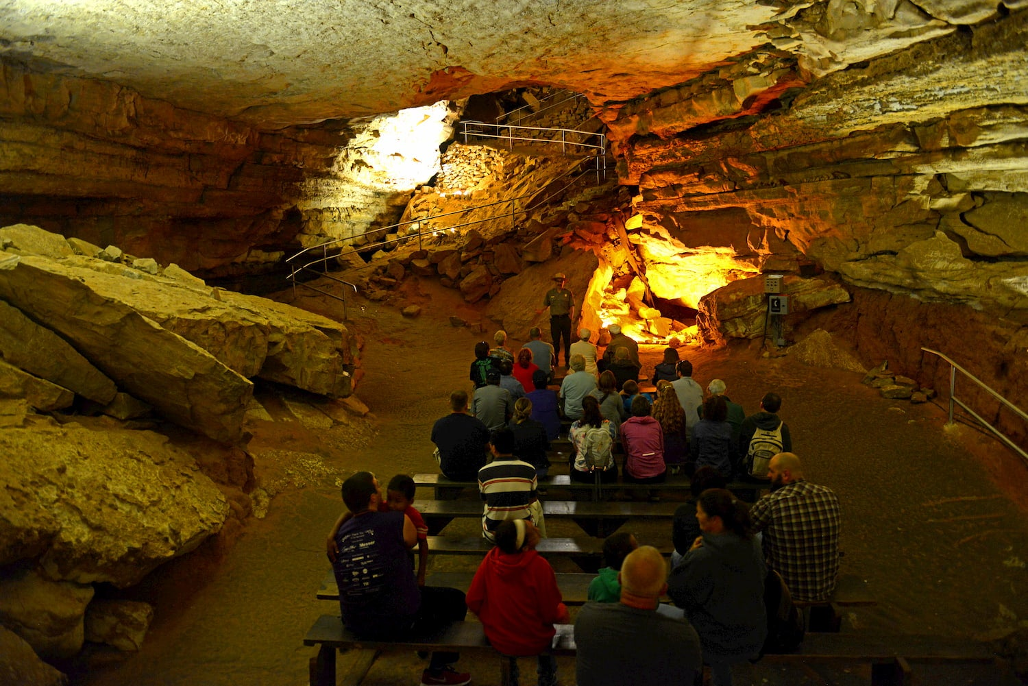 ranger talking to a group of visitors inside mammoth cave