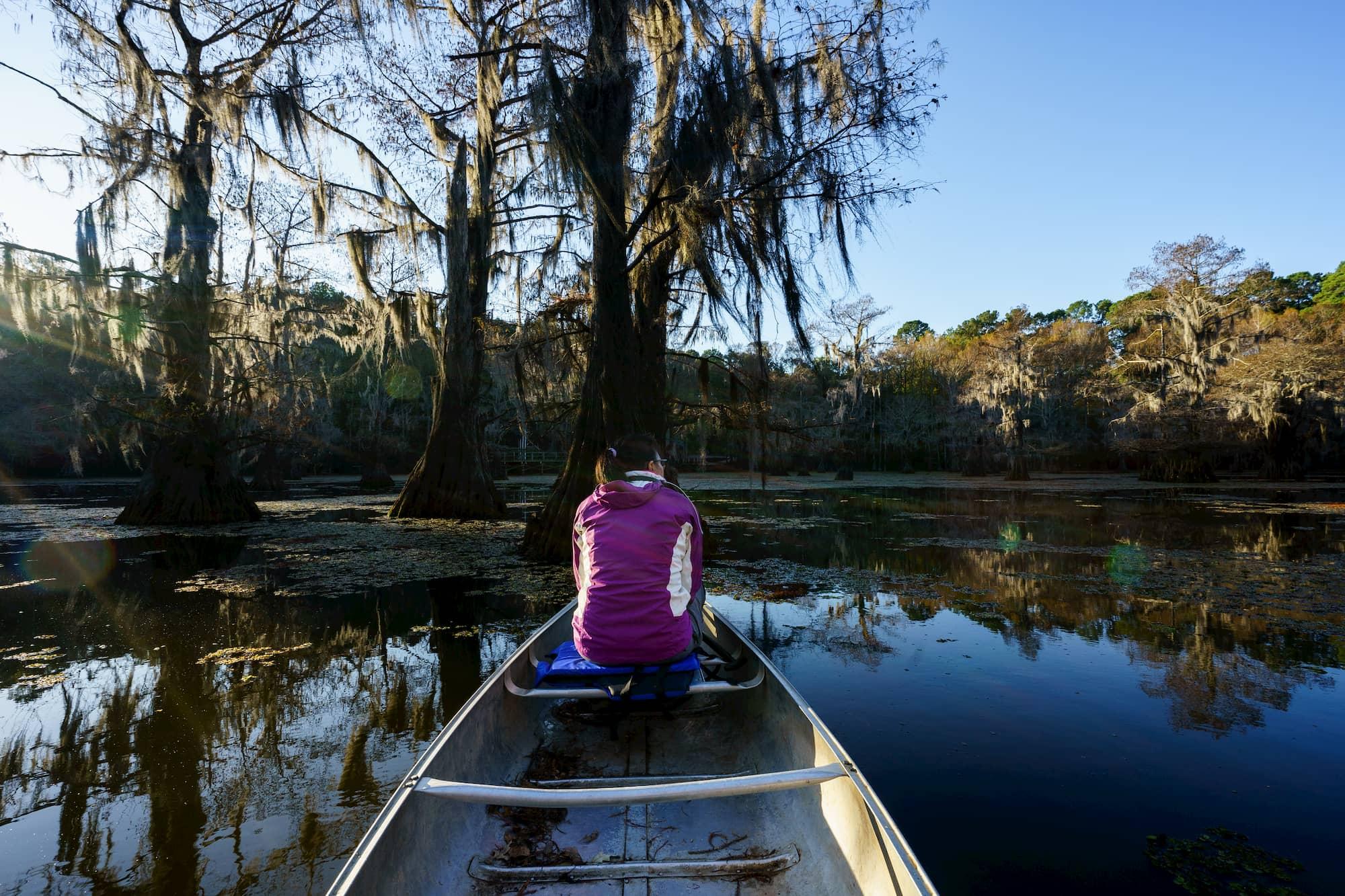 woman in canoe on caddo lake