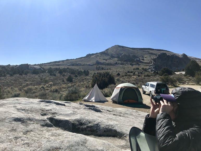 dispersed campsite with woman birding
