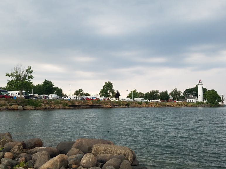 campsites on lakeshore and lighthouse