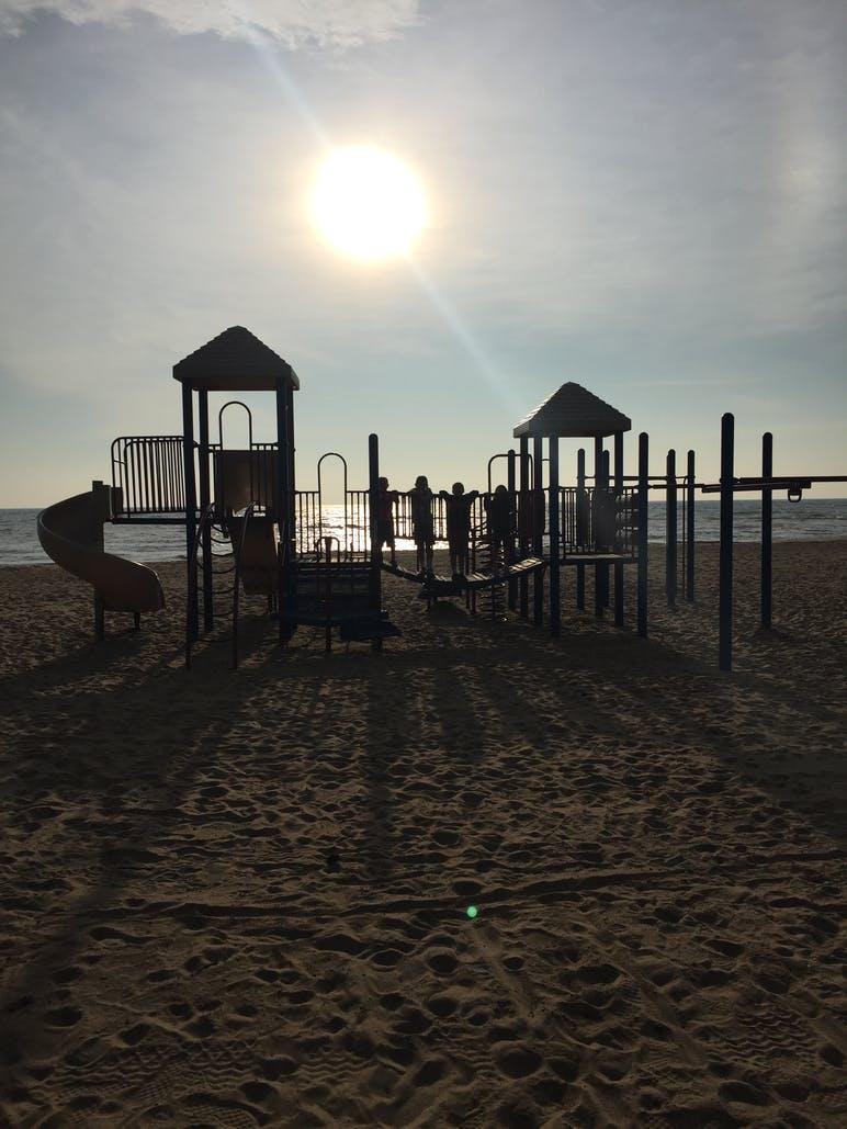 sillhoutte of playground on beach