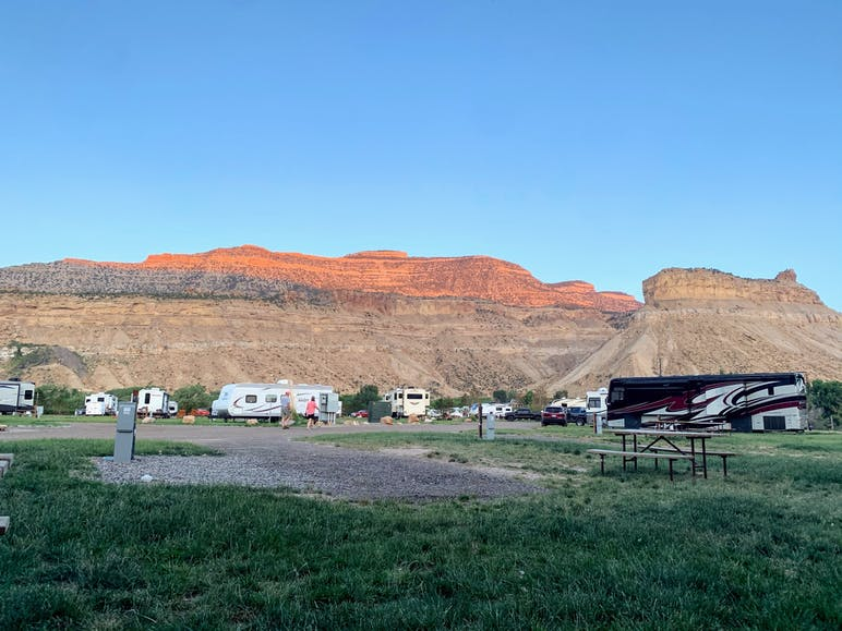 rvs at campground with mesa in background