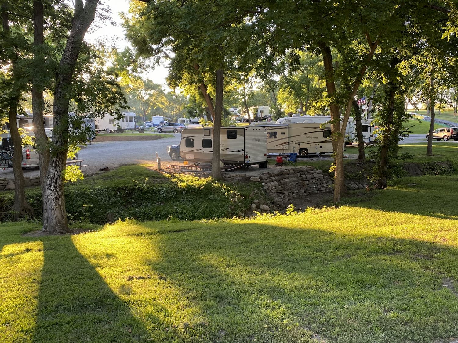 green grass and RVs parked