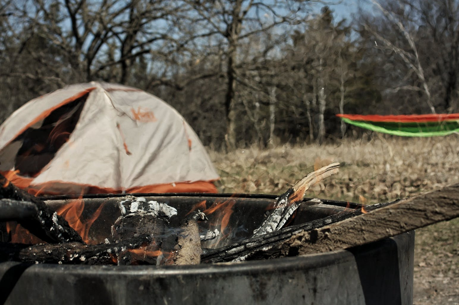 campfire ring and tent at campsite
