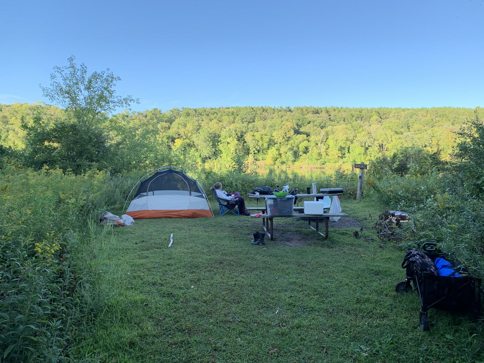 campsite surrounded by forested hills