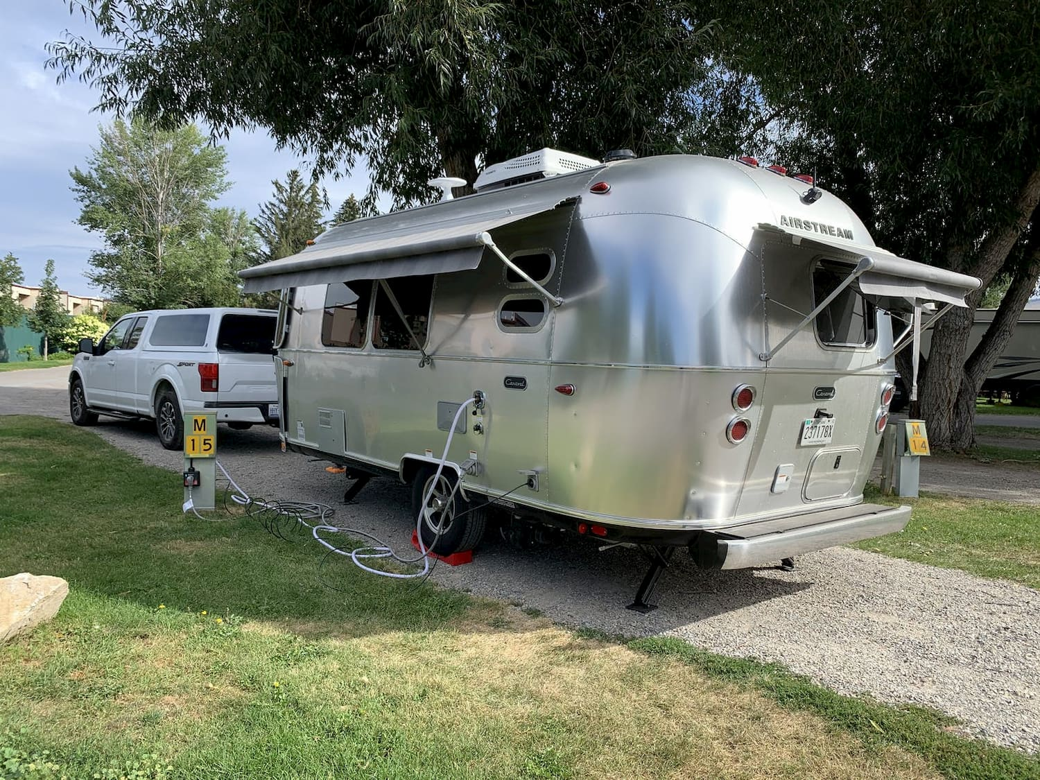 airstream trailer parked at campsite