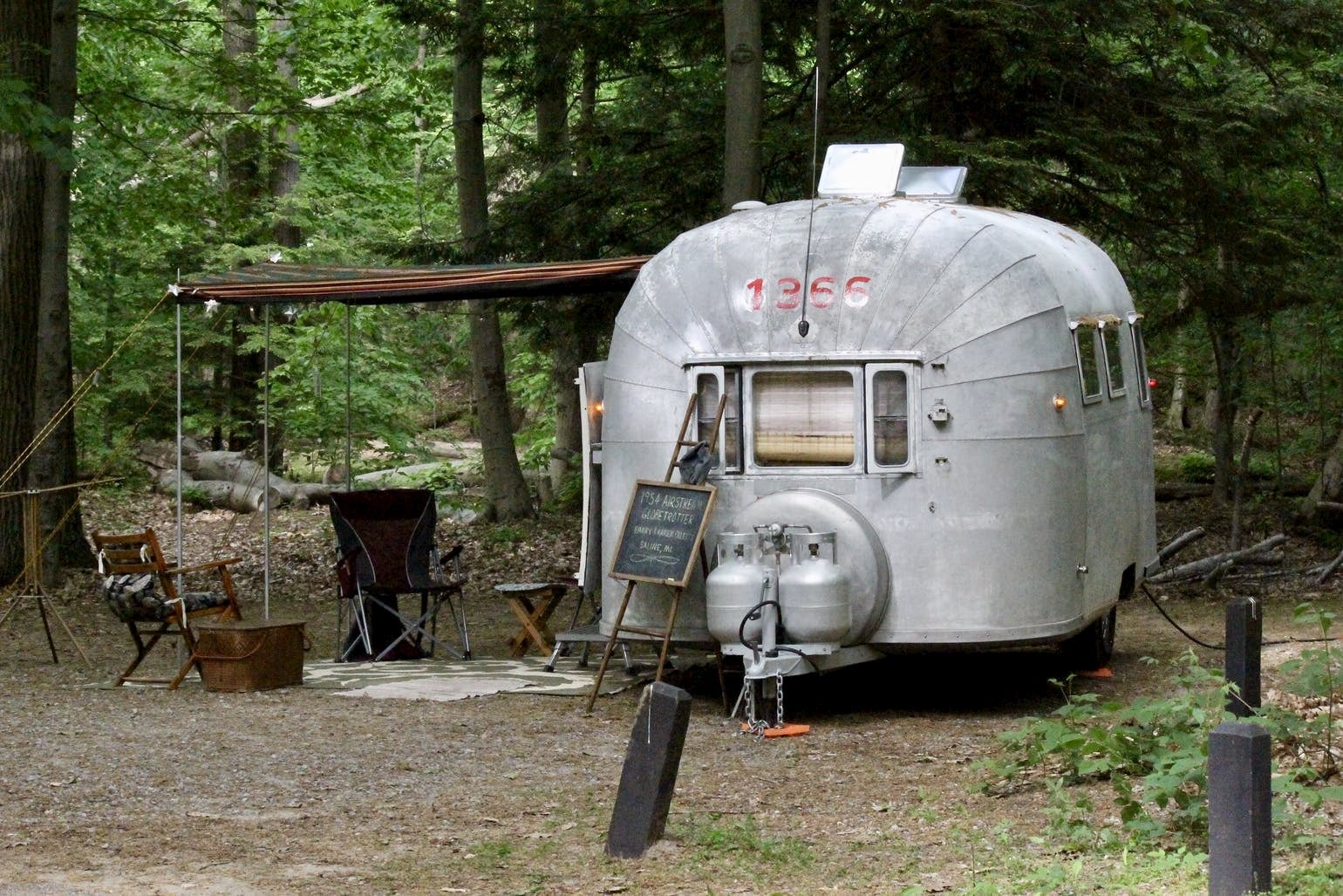 Vintage airstream set up i the woods of Southern Michigan.