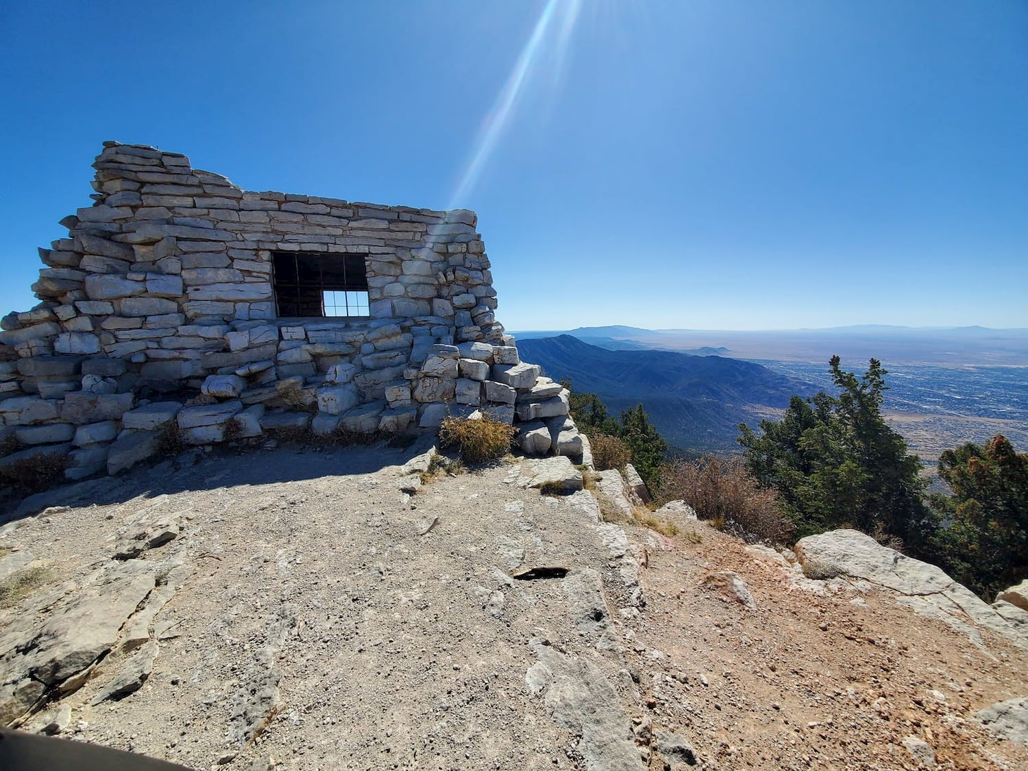stone building on a hill and scenic overlook