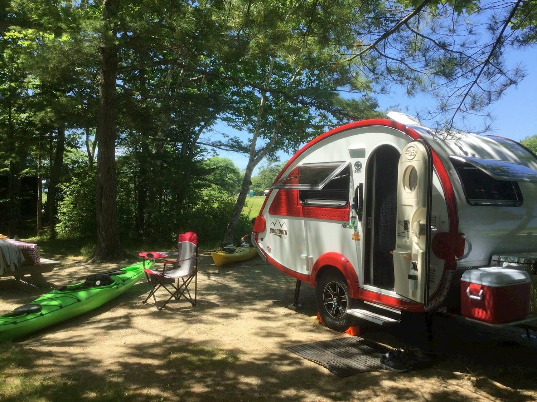 teardrop trailer and kayaks at campsite