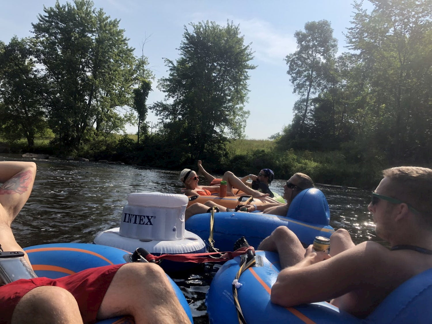 friend floating and drinking in a river