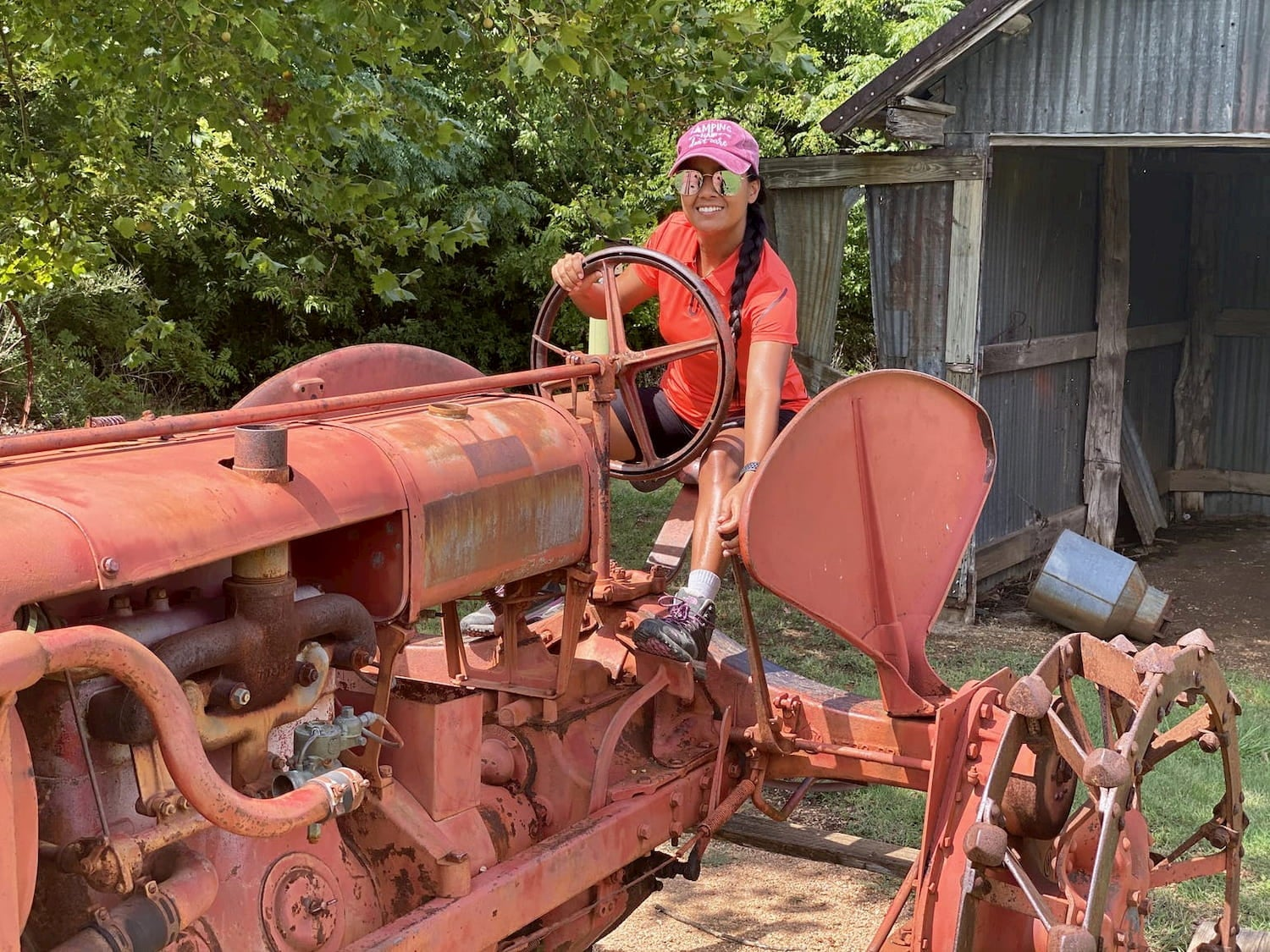 woman smiling on old timey tractor