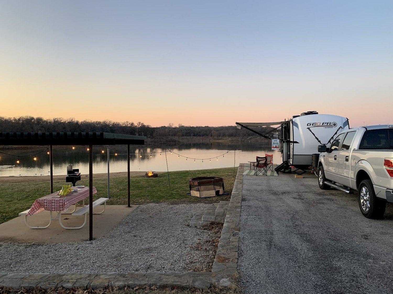 pull-behind set up at a lake at sunset