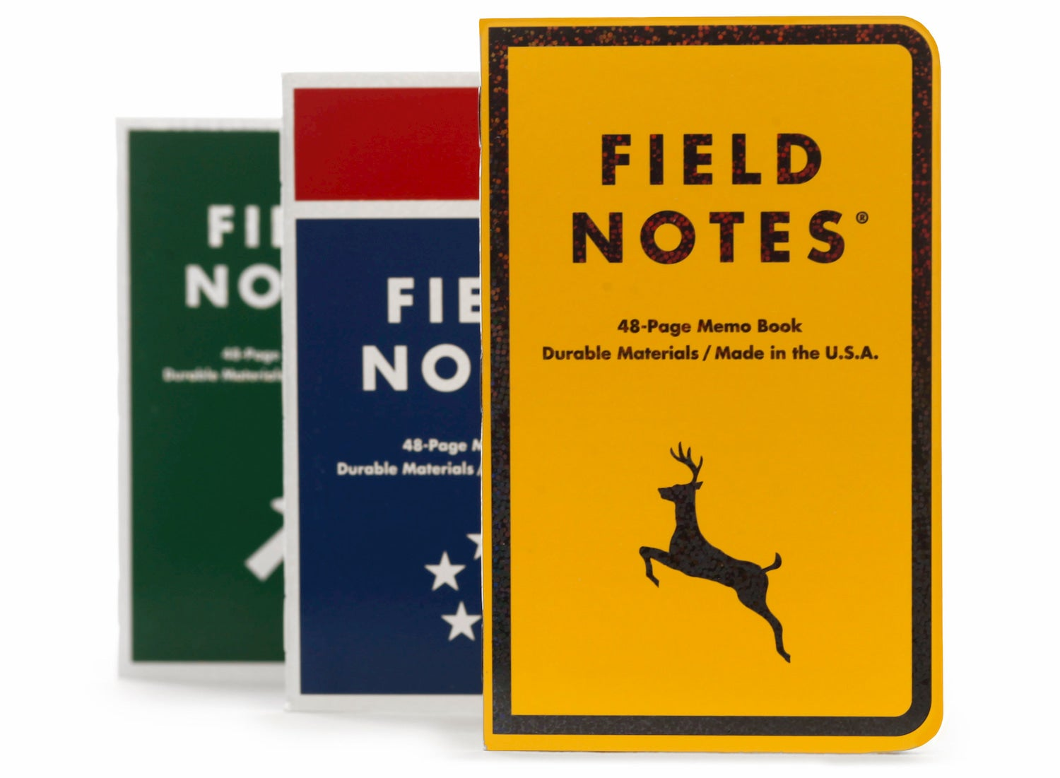 three field note notebooks side by side