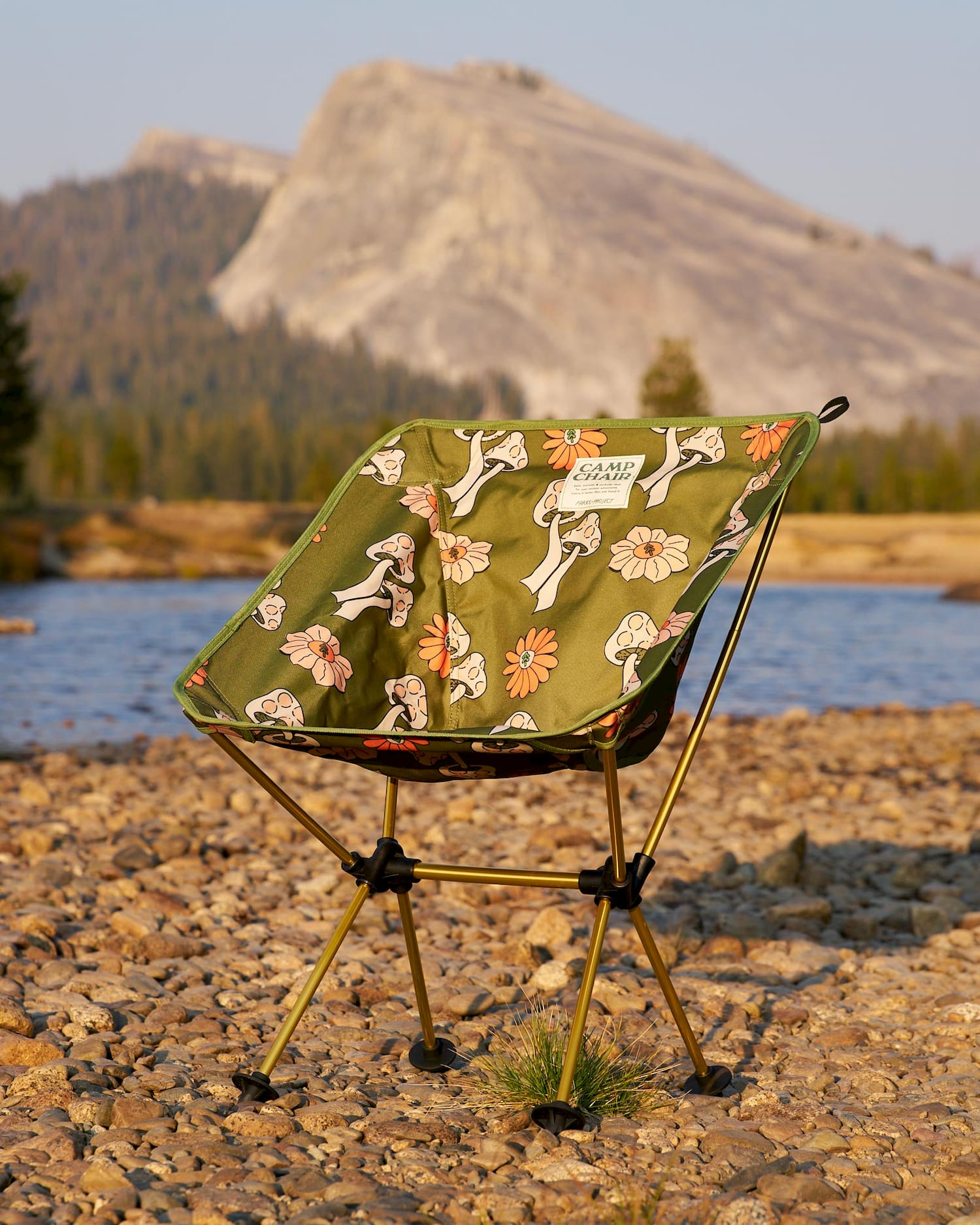 shrooms packable chair infront of water and rock