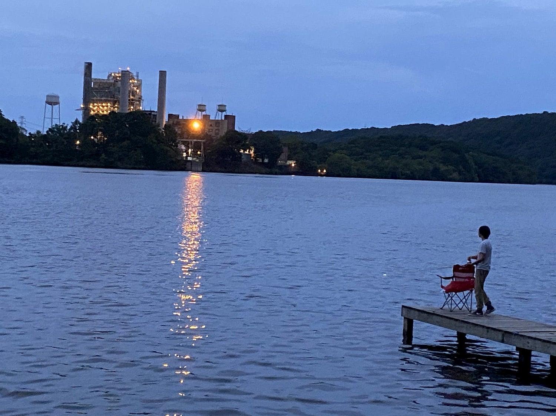 boy on dock at sunset