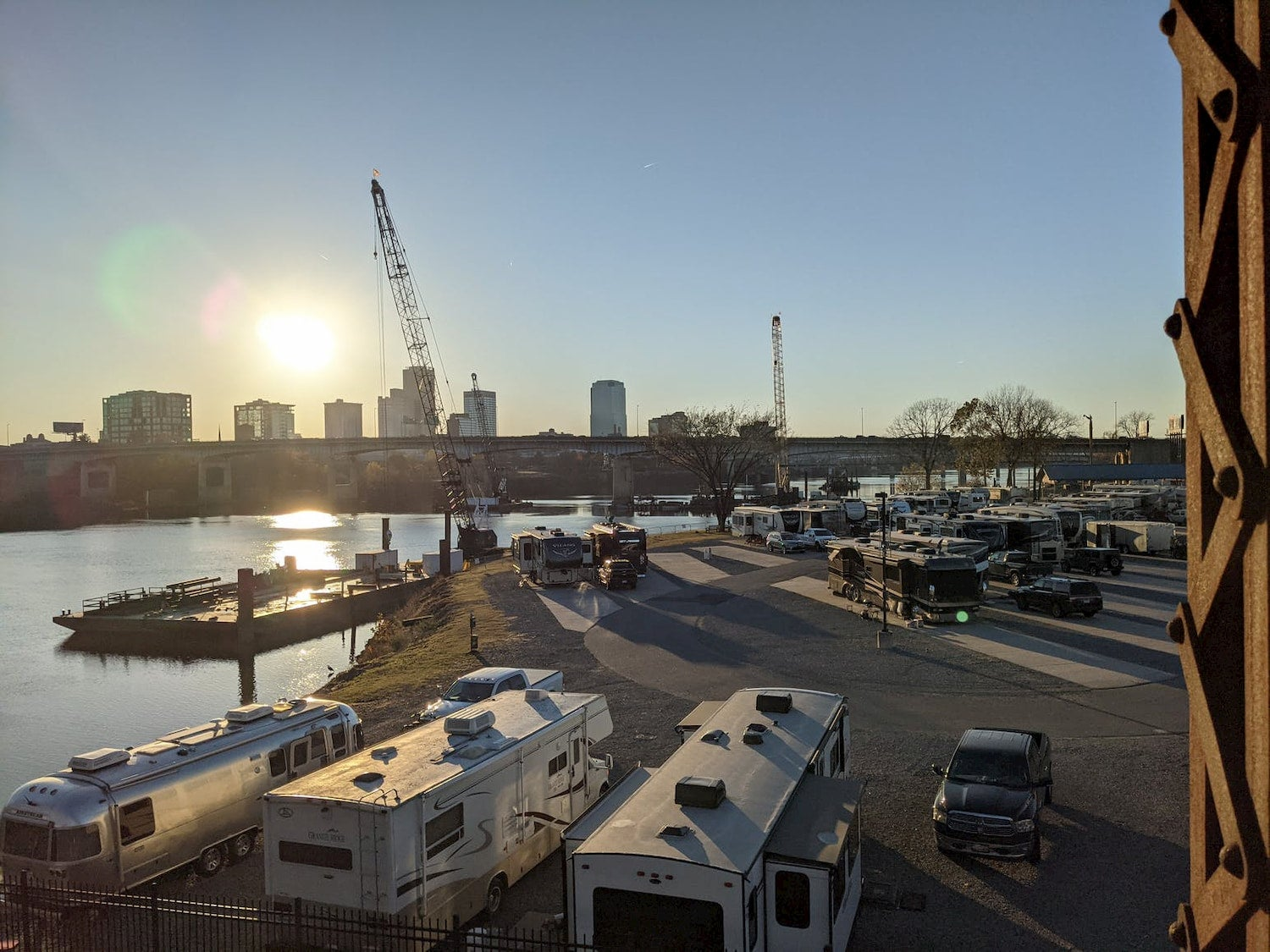 RV park near river with skyline in the background