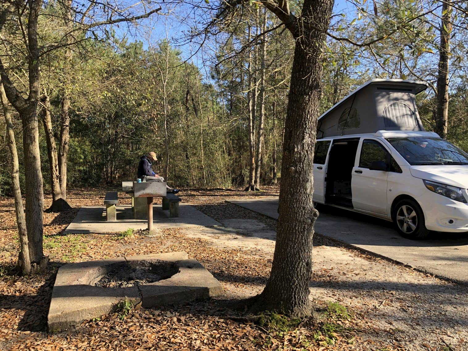 Van with pop up roof parked at campsite in Louisiana.