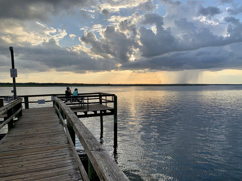 fishing dock at sunset